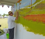 Juan Herman Gonzalez, paints a mural. He'll be doing it on site all weekend.